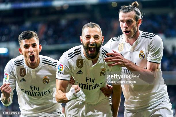 Karim Benzema of Real Madrid celebrates with Gareth Bale and Dani Cabellos after scoring his sides third goalduring the La Liga match between Real...