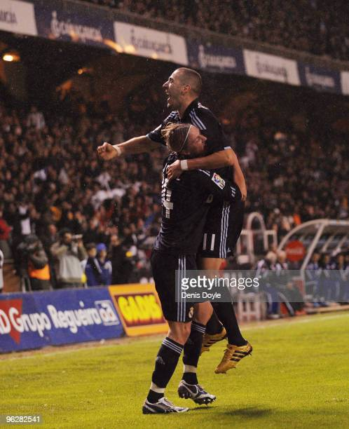Karim Benzema of Real Madrid celebrates with Guti after scoring Real's second goal during the La Liga match between Real Madrid and Deportivo La...