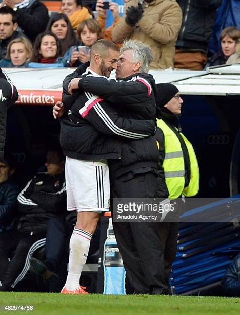 Karim Benzema of Real Madrid celebrates with head coach Carlo Ancelotti after scoring a goal during the La Liga soccer match between Real Madrid CF...