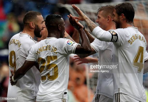 Karim Benzema of Real Madrid celebrates with his teammates after scoring a goal during the La Liga match between Real Madrid and Levante at the...