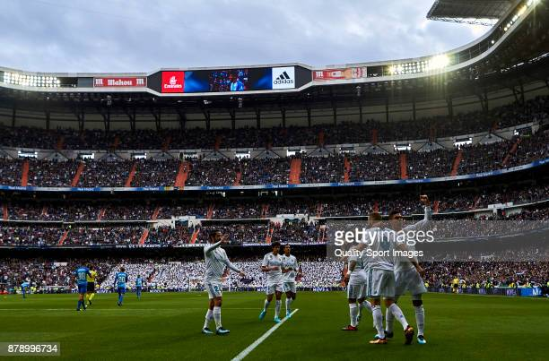 Karim Benzema of Real Madrid celebrates with his teammates after scoring his team's first goal during the La Liga match between Real Madrid and...