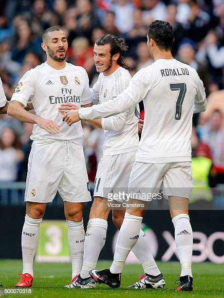 Karim Benzema of Real Madrid celebrates with his teammates Gareth Bale and Cristiano Ronaldo after scoring his team's second goal during the La Liga...