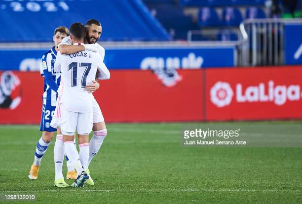 Karim Benzema of Real Madrid celebrates with his teammates Lucas Vazquez of Real Madrid after scoring his team's fourth goal during the La Liga...