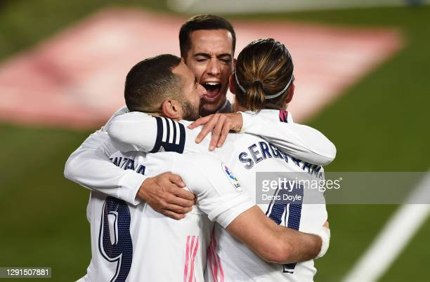 Karim Benzema of Real Madrid celebrates with Lucas Vazquez and Sergio Ramos after scoring his sides second goal during the La Liga Santander match...
