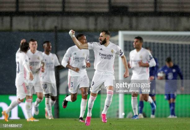 Karim Benzema of Real Madrid celebrates with Luka Modric after scoring their side's first goal during the UEFA Champions League Semi Final First Leg...