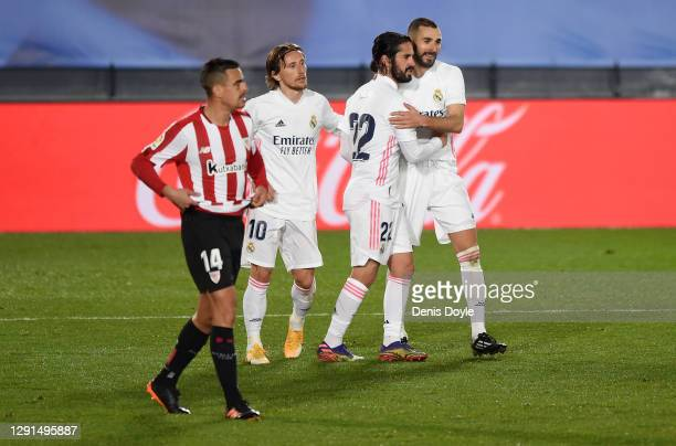 Karim Benzema of Real Madrid celebrates with Luka Modric and Isco after scoring his sides third goal as Dani Garcia of Athletic Bilbao reacts during...