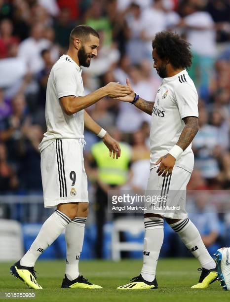 Karim Benzema of Real Madrid celebrates with Marcelo after scoring the opening goal during the Trofeo Santiago Bernabeu match between Real Madrid and...