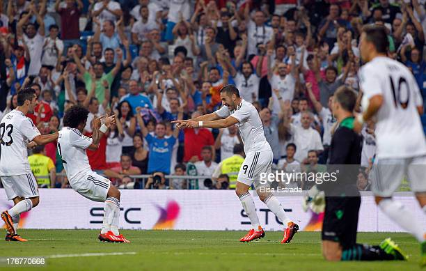 Karim Benzema of Real Madrid celebrates with Marcelo and Isco after scoring during the La Liga match between Real Madrid CF and Real Betis at Estadio...