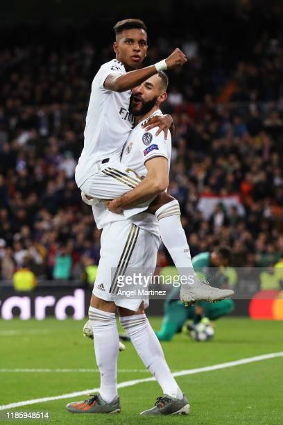 Karim Benzema of Real Madrid celebrates with Rodrygo after scoring his team's fourth goal during the UEFA Champions League group A match between Real...