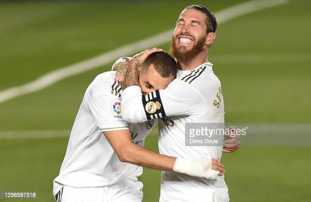 Karim Benzema of Real Madrid celebrates with Sergio Ramos after he scored the second goal from a penalty during the Liga match between Real Madrid CF...