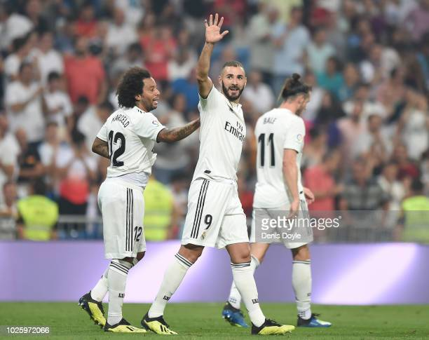 Karim Benzema of Real Madrid celebrates with Sergio Ramos after scoring his teams 3rd goal during the La Liga match between Real Madrid CF and CD...