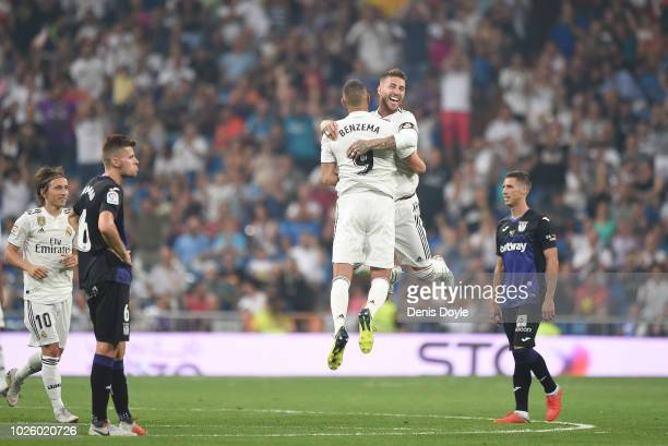 Karim Benzema of Real Madrid celebrates with Sergio Ramos after scoring his teams second goal during the La Liga match between Real Madrid CF and CD...
