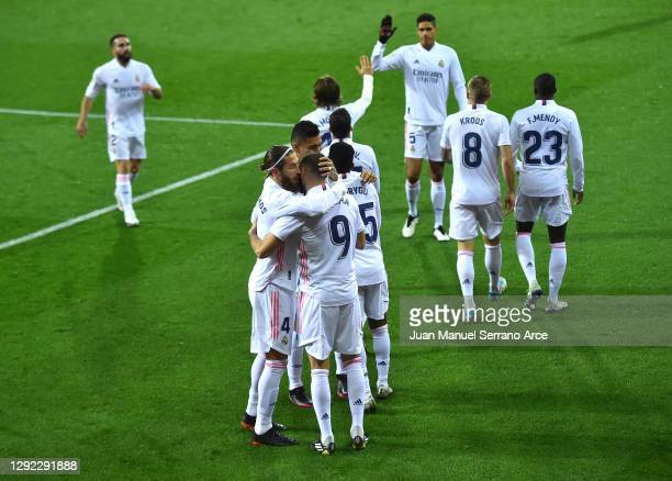 Karim Benzema of Real Madrid celebrates with Sergio Ramos and teammates after scoring their team's first goal during the La Liga Santander match...