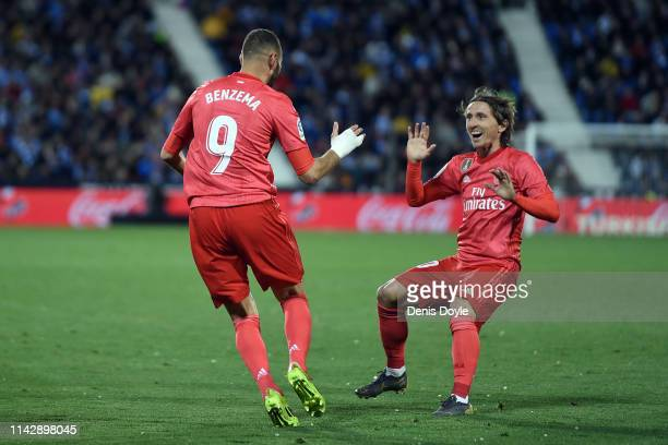 Karim Benzema of Real Madrid celebrates with team mate Luka Modric after scoring their first goal during the La Liga match between CD Leganes and...