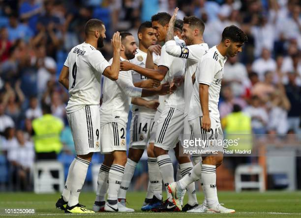Karim Benzema of Real Madrid celebrates with team mates after scoring the opening goal during the Trofeo Santiago Bernabeu match between Real Madrid...