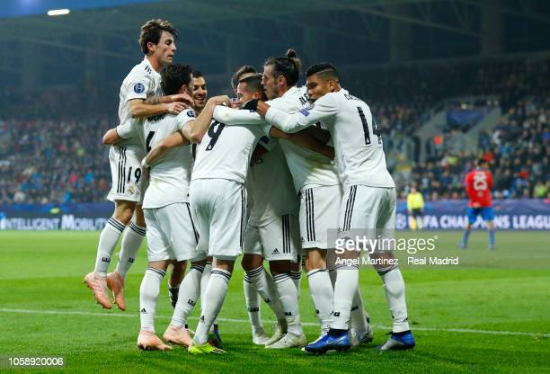 Karim Benzema of Real Madrid celebrates with team mates after scoring their team's third goal during the Group G match of the UEFA Champions League...