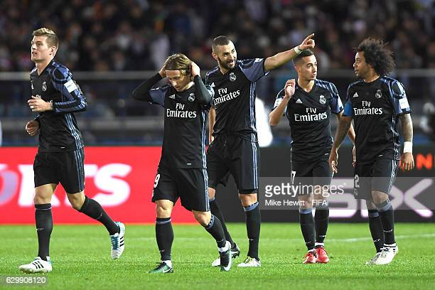 Karim Benzema of Real Madrid celebrates with team mates after scoring his sides first goal during the FIFA Club World Cup Semi Final match between...