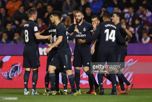 Karim Benzema of Real Madrid celebrates with team mates as he scores his team's second goal from a penalty during the La Liga match between Real...