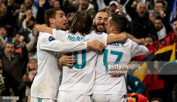 Karim Benzema of Real Madrid celebrates with team mates scoring his team's second goal during the UEFA Champions League Semi Final Second Leg match...