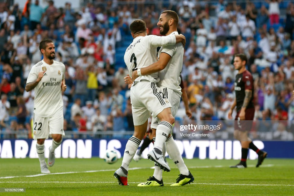 Karim Benzema (R) of Real Madrid celebrates with teammate Daniel Carvajal after scoring the opening goal during the Trofeo Santiago Bernabeu match between Real Madrid and AC Milan at Estadio Santiago Bernabeu on August 11, 2018 in Madrid, Spain.