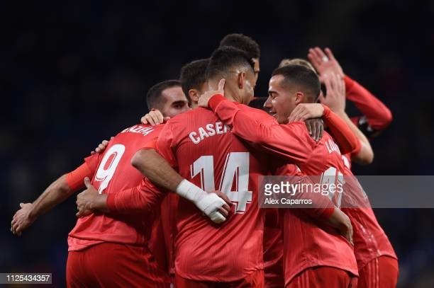 Karim Benzema of Real Madrid celebrates with teammates after scoring his team's third goal during the La Liga match between RCD Espanyol and Real...