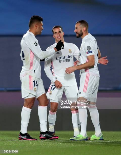 Karim Benzema of Real Madrid celebrates with teammates Lucas Vazquez and Casemiro after scoring their team's first goal during the UEFA Champions...