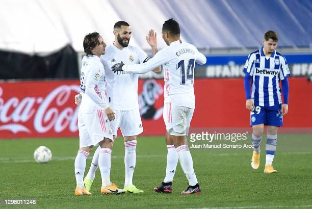 Karim Benzema of Real Madrid celebrates with teammates Luka Modric and Casemiro after scoring their team's fourth goal during the La Liga Santander...