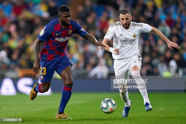Karim Benzema of Real Madrid CF battle for the ball with Samuel Umtiti of FC Barcelona during the Liga match between Real Madrid CF and FC Barcelona...