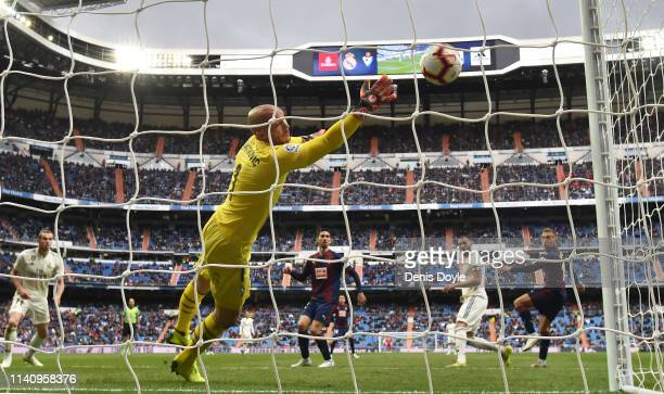 Karim Benzema of Real Madrid CF beats Marki Dmitrovic of SD Eibar to score Real's opening goal during the La Liga match between Real Madrid CF and SD...