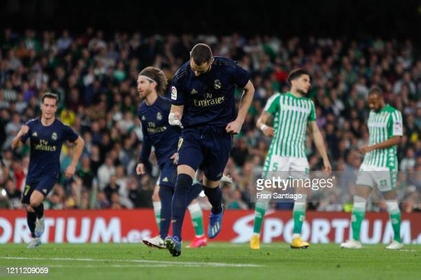 Karim Benzema of Real Madrid CF celebrates after scoring his team's first goal from the penalty spot during the Liga match between Real Betis...