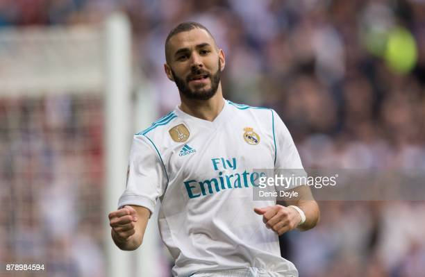 Karim Benzema of Real Madrid CF celebrates after scoring his team's opening goal during the La Liga match between Real Madrid and Malaga at Estadio...