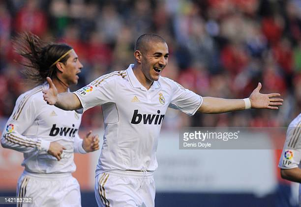 Karim Benzema of Real Madrid CF celebrates after scoring Real's opening goal during the La Liga match between CA Osasuna and Real Madrid CF at...