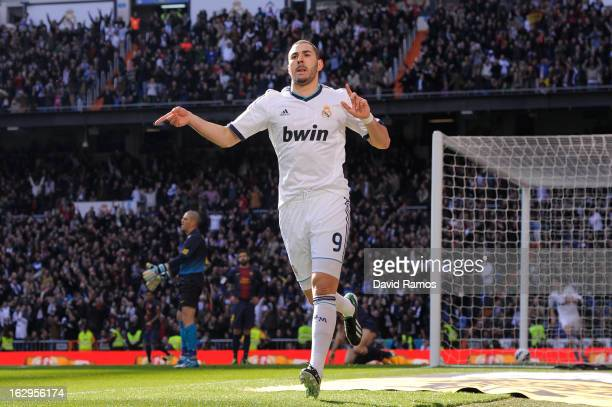 Karim Benzema of Real Madrid CF celebrates after scoring the opening goal during the La Liga match between Real Madrid CF and FC Barcelona at...