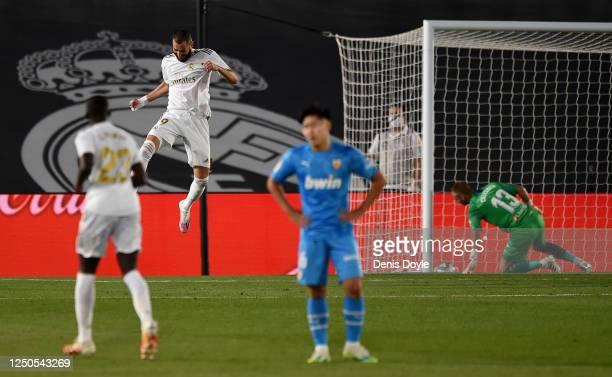 Karim Benzema of Real Madrid CF celebrates scoring his teams third goal during the Liga match between Real Madrid CF and Valencia CF at Estadio...