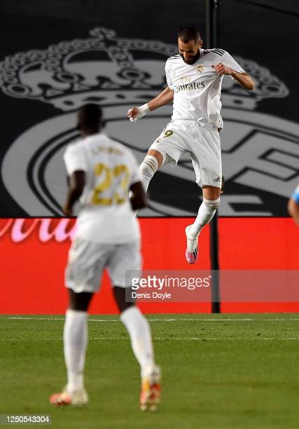Karim Benzema of Real Madrid CF celebrates scoring his teams third goal during the Liga match between Real Madrid CF and Valencia CF at Estadio...