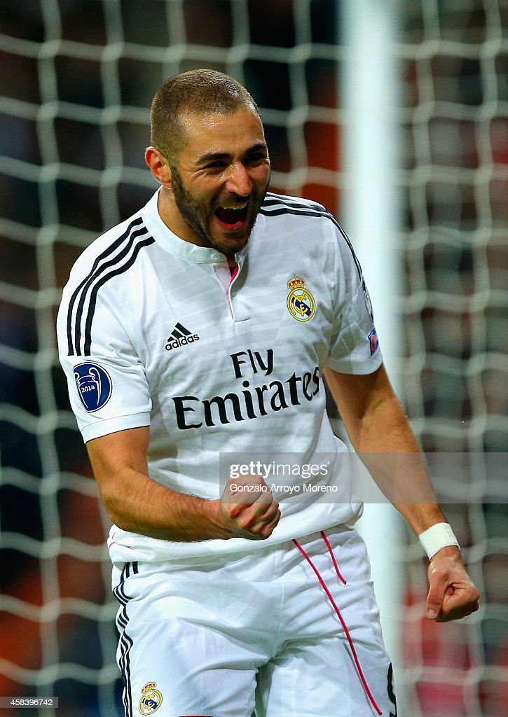 Karim Benzema of Real Madrid CF celebrates scoring the opening goal during the UEFA Champions League Group B match between Real Madrid CF and Liverpool FC at Estadio Santiago Bernabeu on November 4, 2014 in Madrid, Spain.