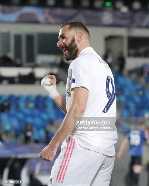 Karim Benzema of Real Madrid CF celebrates scoring their opening goal during the UEFA Champions League Round of 16 match between Real Madrid and...