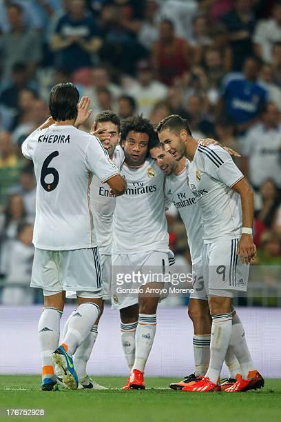 Karim Benzema of Real Madrid CF celebrates scoring their opening goal with teammates Francisco Roman Alarcon alias Isco Marcelo Daniel Carvajal and...