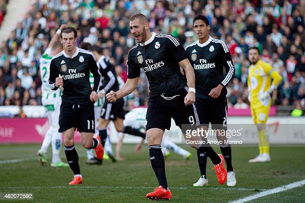 Karim Benzema of Real Madrid CF celebrates scoring their opening goal during the La Liga match between Cordoba CF and Real Madrid CF at El Arcangel...