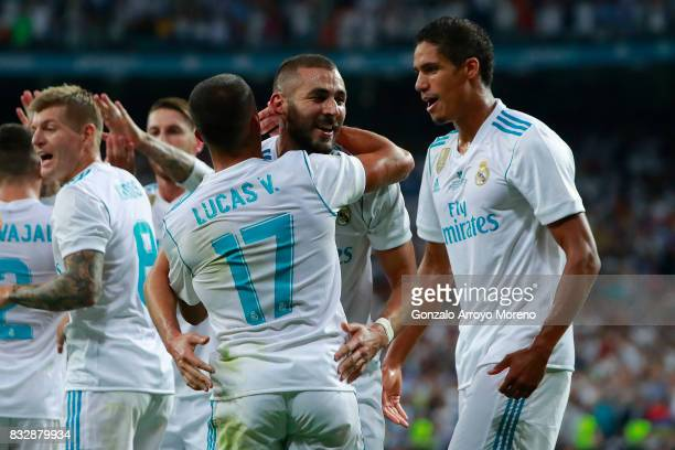 Karim Benzema of Real Madrid CF celebrates scoring their second goal with teammates Marcelo and Raphael Varane during the Supercopa de Espana Final...