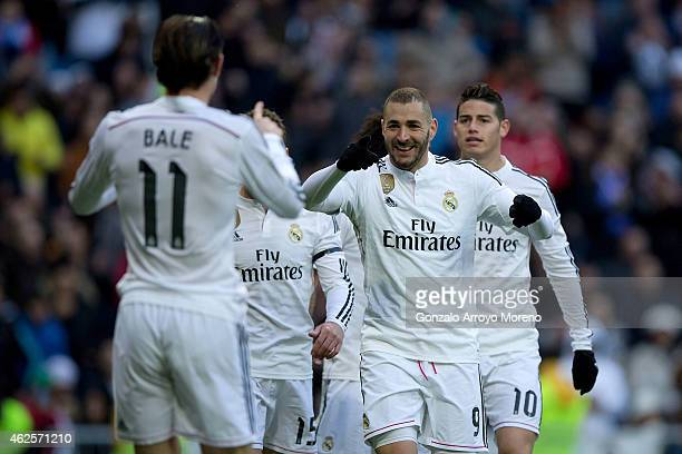 Karim Benzema of Real Madrid CF celebrates scoring their third goal with teammate Gareth Bale during the La Liga match between Real Madrid CF and...