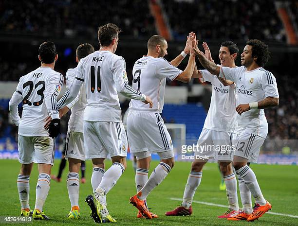 Karim Benzema of Real Madrid CF celebrates with Angel Di Maria and Marcelo after scoring Real's 2nd goal during the La Liga match between Real Madrid...