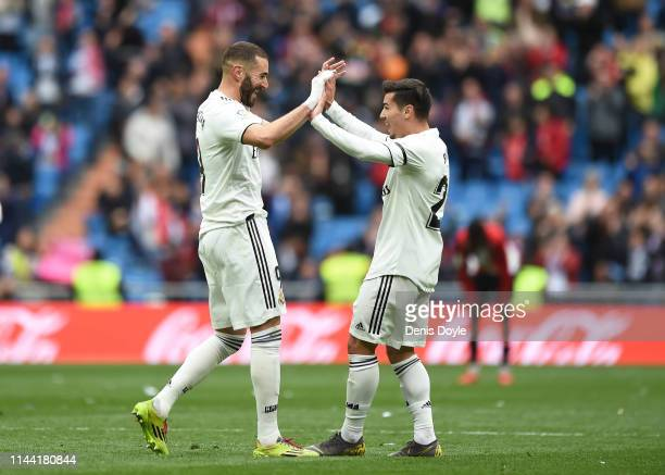 Karim Benzema of Real Madrid CF celebrates with Brahim Diaz after scoring Real's third goal during the La Liga match between Real Madrid CF and...