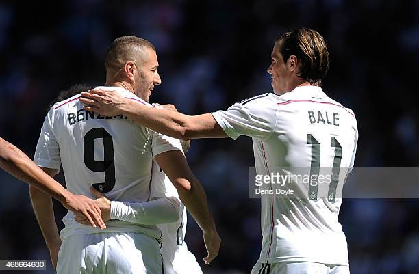 Karim Benzema of Real Madrid CF celebrates with Gareth Bale after scoring his team's 7th goal during the La Liga match between Real Madrid CF and...
