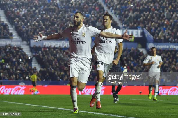 Karim Benzema of Real Madrid CF celebrates with his team magte Sergio Reguilon after scoring his team's first goal from the penalty spot during the...