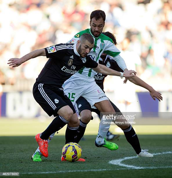 Karim Benzema of Real Madrid CF competes for the ball with David Rodrguez of Cordoba CF during the La Liga match between Cordoba CF and Real Madrid...