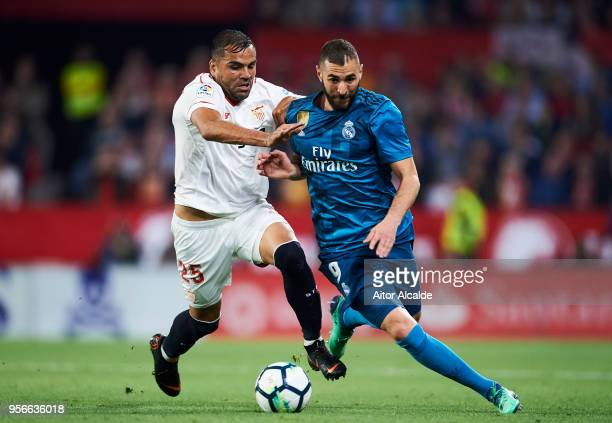 Karim Benzema of Real Madrid CF competes for the ball with Gabriel Mercado of Sevilla FC during the La Liga match between Sevilla FC and Real Madrid...