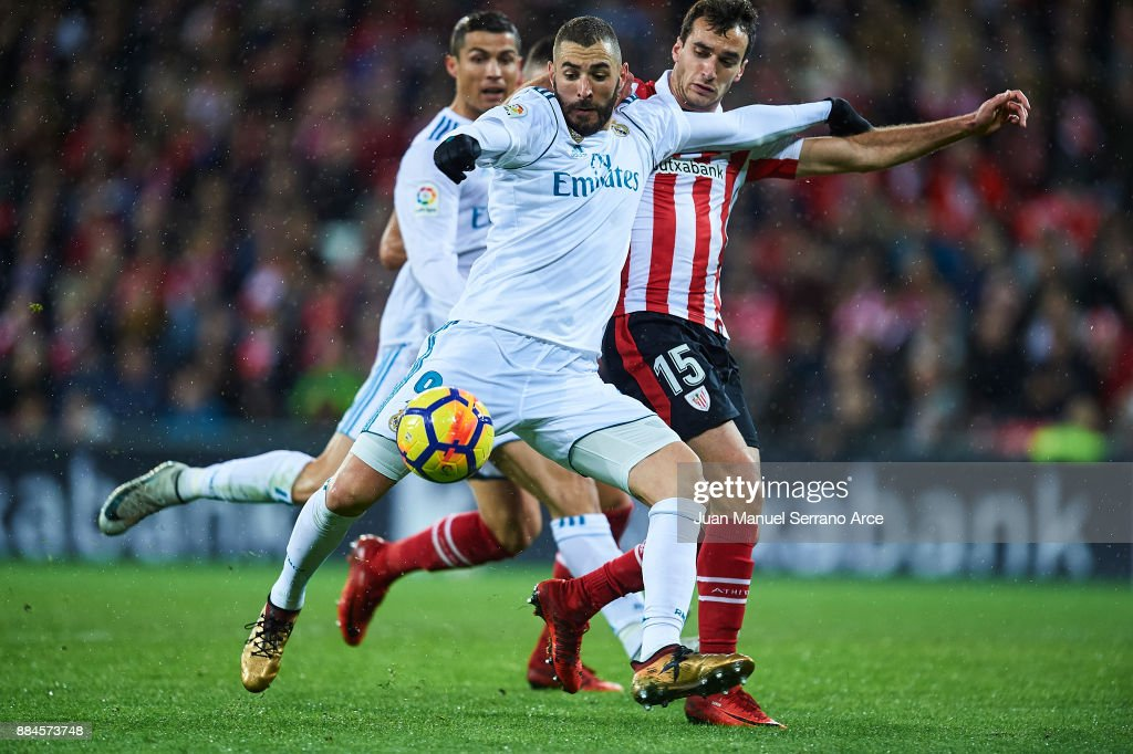 Karim Benzema of Real Madrid CF (L) competes for the ball with Inigo Lekue of Athletic Club (R) during the La Liga match between Athletic Club and Real Madrid at Estadio de San Mames on December 2, 2017 in Bilbao, Spain.