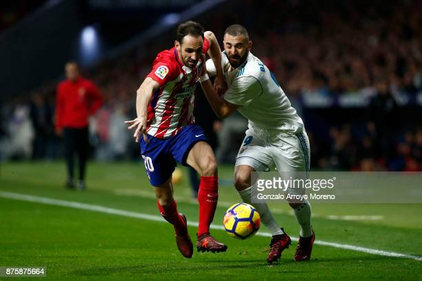 Karim Benzema of Real Madrid CF competes for the ball with Juan Francisco Torres alias Juanfran of Atletico de Madrid during the La Liga match...