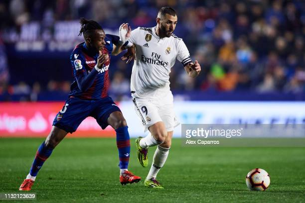 Karim Benzema of Real Madrid CF fights for the ball with Cheick Ives Doukoure of Levante UD during the La Liga match between Levante UD and Real...